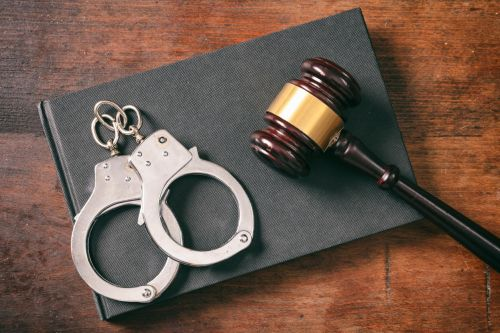 Handcuffs, gavel and law book